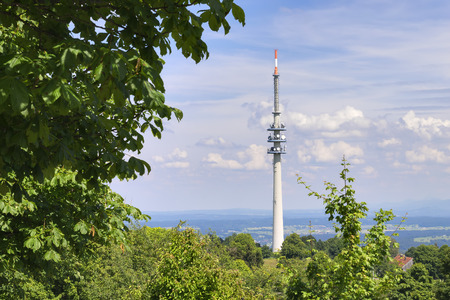 Landscape with broadcasting tower with blue sky and white clouds