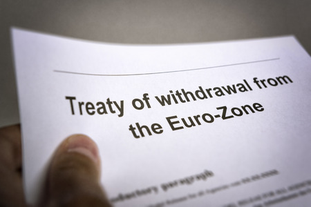withdrawal: Man holding an treaty on the withdrawal from the euro zone in the hand