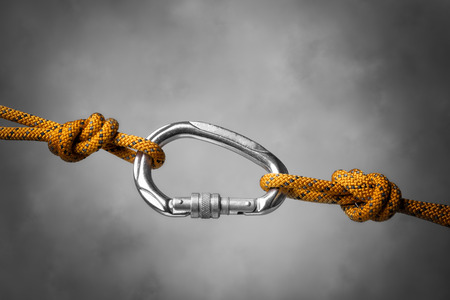 hook up: Image of a carabiner hook with a climbing rope