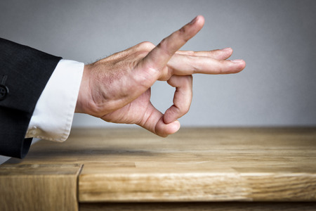 distrust: Business Man shoots with his finger something off Stock Photo