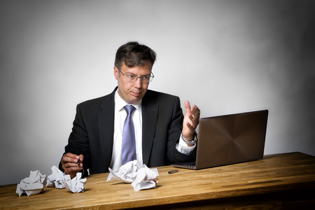 overworked: Overworked businessman with lot of files on his desk Stock Photo