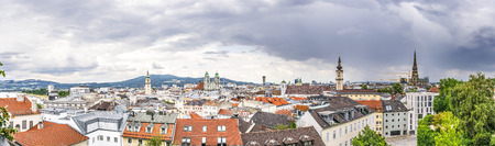 linz: Panorama image of Linz in Austria with dramatic clouds Stock Photo