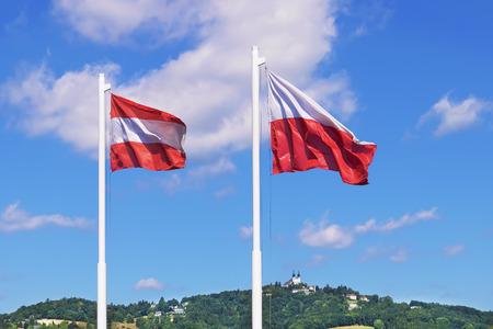 linz: Austria flags with Postlingberg in Linz Stock Photo