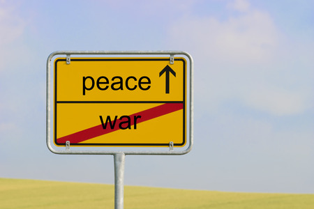 freeing: Yellow town sign with text war peace