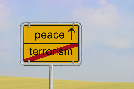 Yellow town sign with text terrorism peace Stock Photo