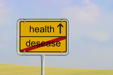 desease: Yellow town sign with text desease health Stock Photo