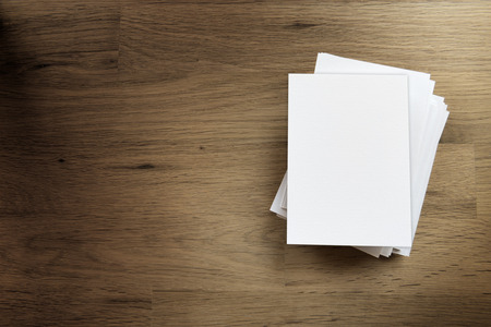 solicitation: Paper blank card and free space on a wooden table
