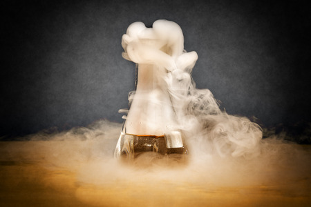 Measuring glass with smoke on a table of a chemical laboratory Stock Photo