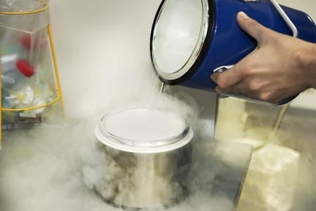nitrogen: Person in a chemistry lab works with liquid nitrogen