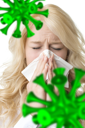 bacillus: Portrait of a ill blond woman who is sneezing bacillus in a virus Stock Photo