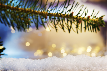 artificial lights: Image of a branch and artificial snow with bokeh lights in background and free space