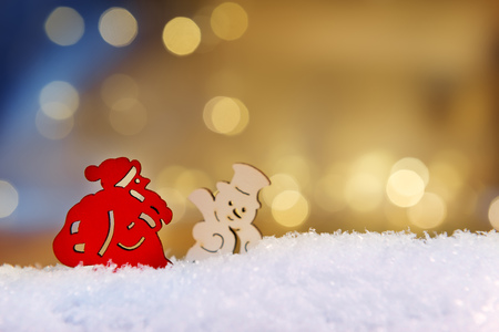 artificial lights: Image of santa claus and snowman on artificial snow and bokeh lights in background and free space