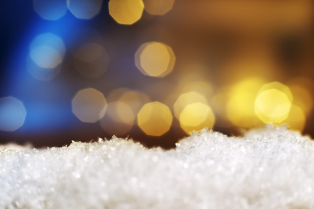Image of artificial snow and bokeh lights in background and free space Stock Photo