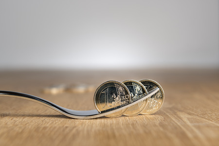 silver coins: Image of euro coins on a silver spoon