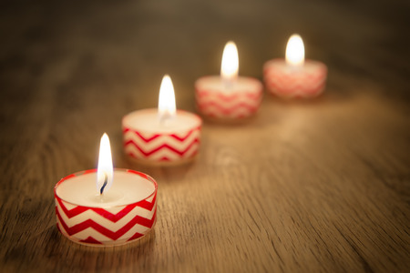 christmas lights display: Romantic image of candles on a wooden table