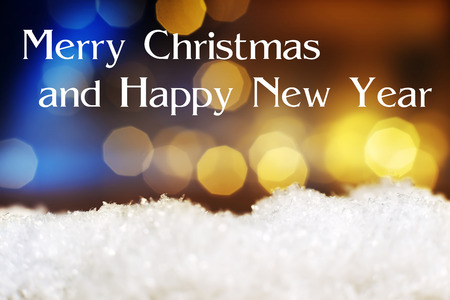 artificial lights: Image of artificial snow and bokeh lights in background and text Merry Christmas and Happy New Year
