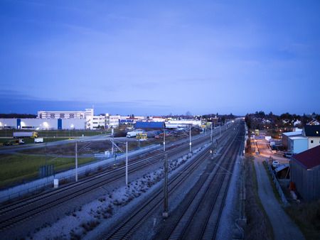industrie: Night scene of railroad tracks and industrie buildings of a small village in Germany