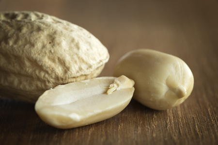shelled: Peanut shelled and unshelled on a wooden table Stock Photo