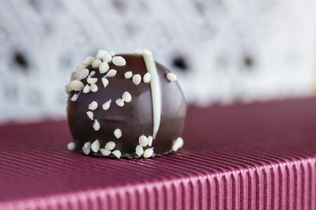 fancy sweet box: Image of a chocolate praline with sugar