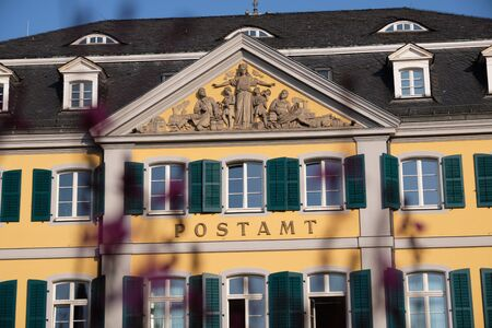 Image of old post office in Bonn with flowers in foreground in Germany