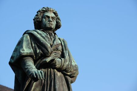 Statue of Ludwig van Beethoven in Bonn, Germany with blue sky in background