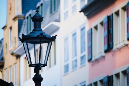 Historic street lamp with historic houses in background in Bonn, Germany Stock fotó