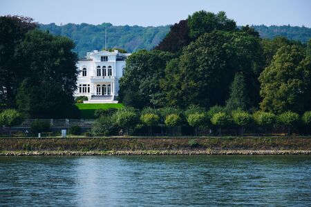 View to Villa Hammerschmidt with river and trees in Bonn, Germany