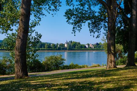 Bank of Rhine with river, trees and meadow in Bonn, Germany Stock fotó