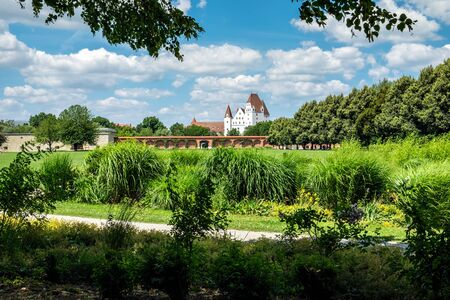 Image of park with view to castle in Ingolstadt, Germany in summer