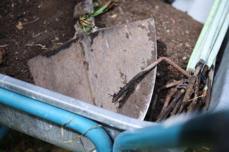 Shovel lies in a wheelbarrow in Bavaria, Germany