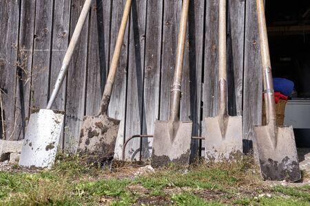 Shovels lean against a shed in Bavaria, Germany