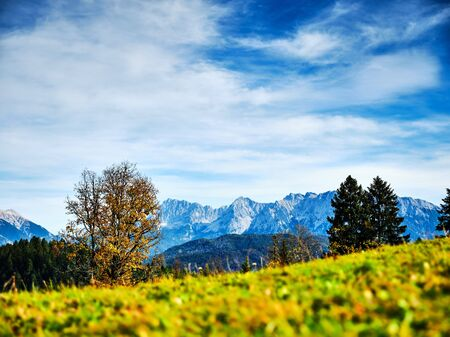 View from the top of mountain Eckbauer in Bavaria to alps in the region of Garmisch-Partenkirchen, Germany in autumn on a sunny day in autumn Stock fotó