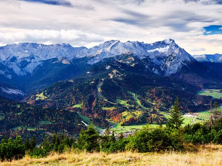 View to the alps from the top of mountain Wank in Garmisch-Partenkirchen in Bavaria, Germany on a sunny day in autumn Stock fotó