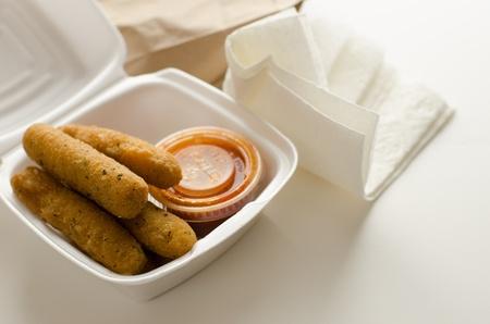 Mozzarella Sticks in Takeout Container