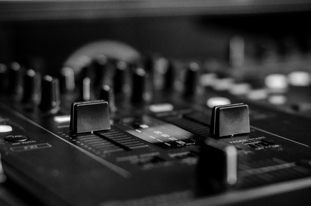 Black   White photo of a DJ mixing board
