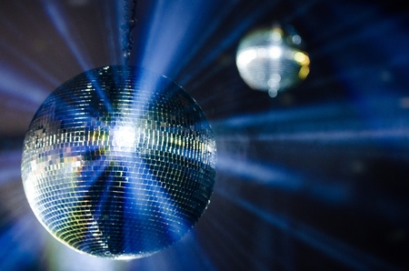 mirrored: Blue Light Reflects from Shiny Disco Balls