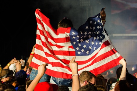 Photo taken as an EDM Concert Attendee Raises American Flag