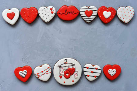 Valentine's day Homemade cookies on Ultimate Gray background, top view. Space for text. Delicious and sweet, covered with icing with a beautiful pattern gingerbread