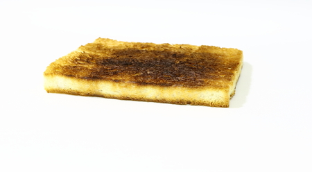 burned toast isolated on white