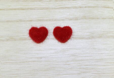 Red heart on the wooden floor.