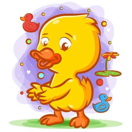 The cartoon of a little yellow duck dancing on the green grass with the happy face