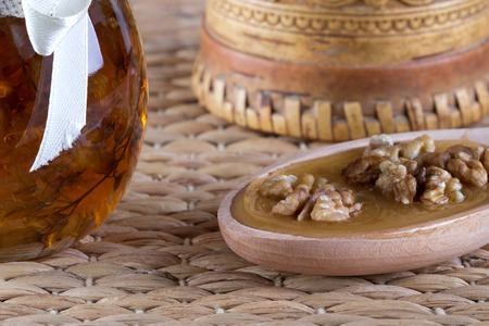 breackfast: Honey and nuts on rustic table