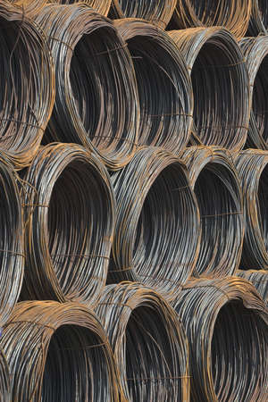 Group of steel coils prepared for shipping in dock area photo