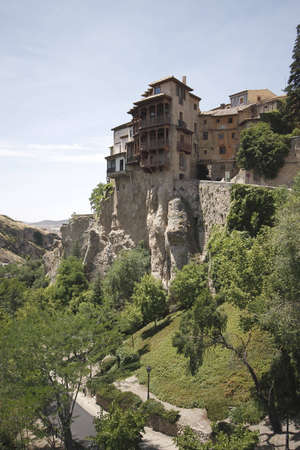 cuenca: Hanging houses (Casas colgadas) in the medieval town of Cuenca, in Castilla La Mancha, Spain. These buildings, with their medieval wooden balconies over stone cantilevers, are one of the most famous places in Spain. Madrid is about 165 Km far