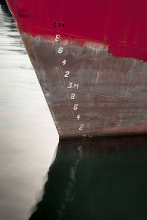 Water level measurement on a ship. Red ship waterline abstract close up photo