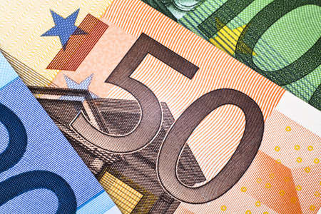 currency exchange: Close up of a 50 euro note between other euro banknotes Stock Photo