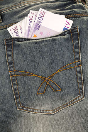 Euro paper money in pocket background.Close up of three 500 Euro banknotes in a jeans pocket.Paper Currency. Studio shot. photo