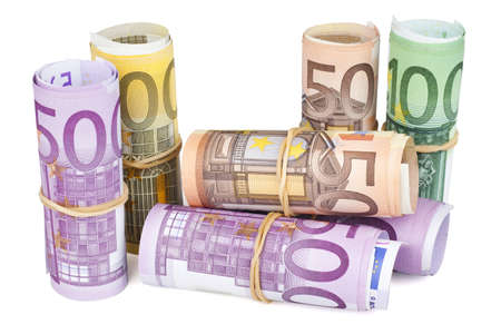 Euro banknotes rolled up on white background. photo