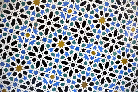 building plans: Glazed tiles on a wall in the Alcazar of Seville, Spain. Detail of wall mosaics in the Reales Alcazares of Sevilla,Spain.