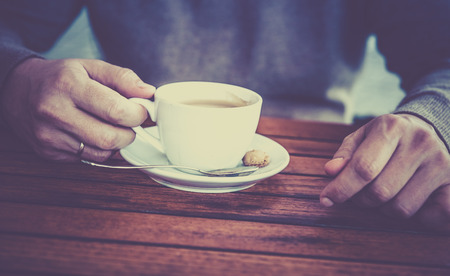 coffee spoon: hands, cup of coffee, spoon, businessman Stock Photo